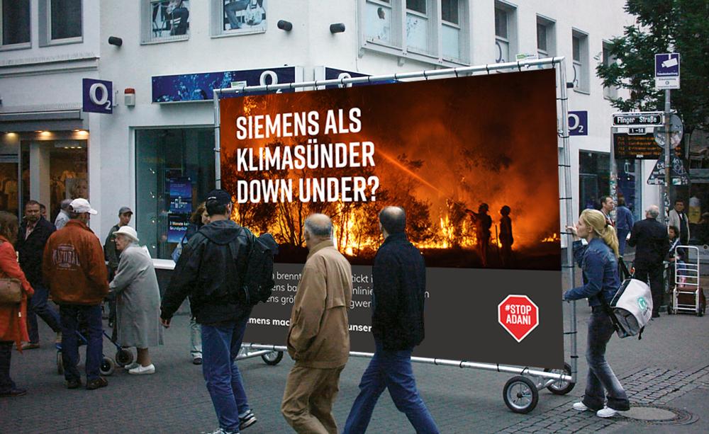 """Photo: Mock up of a billboard outside Siemens' head office in Munich, Germany.""""Siemens as a climate sinner down under?"""""""